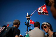 A protestor balances on top of a pole wearing a 'Guy Fawkes' mask and waving a Turkish flag with a Mustafa Kemal Ataturk portrait on it during an anti- government demonstration at Taksim Square, in Istanbul, Turkey, 09 June 2013. Protests against the Islamic-conservative government of Prime Minister Erdogan began 31 May after a police raid against activists angered over a development project in Istanbul escalated and turned violent. A combative Prime Minister Recep Tayyip Erdogan on 09 June addressed core supporters of his conservative Islamic-rooted Justice and Development Party (AKP) in some provincial cities, telling them to 'teach the protesters a lesson' - at least in next year's local elections.