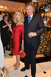RICHARD & BASIA BRIGGS at a party to celebrate the publication of 'A Designer's Life' by Nicky Haslam held at Ralph Lauren, 1 New Bond Street, London on 19th November 2014.