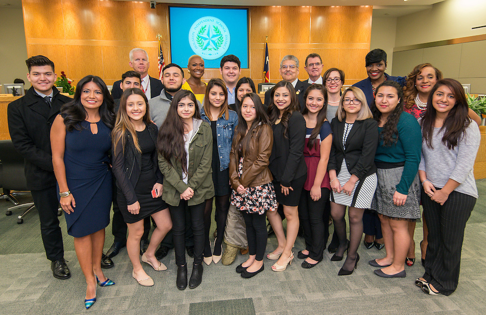 Chavez High School students pose for a photograph with officials following swearing in ceremonies for newly elected Houston ISD trustees, January 14, 2016.