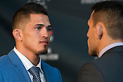 DALLAS, TX - MARCH 12:  UFC Lightweight Champion Anthony Pettis faces off against Rafael Dos Anjos during the UFC 185 Ultimate Media Day at the American Airlines Center on March 12, 2015 in Dallas, Texas. (Photo by Cooper Neill/Zuffa LLC/Zuffa LLC via Getty Images) *** Local Caption *** Anthony Pettis; Rafael Dos Anjos