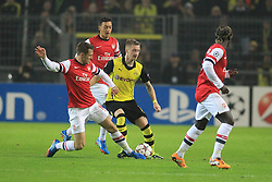 06.11.2013, Signal Iduna Park, Dortmund, GER, UEFA CL, Borussia Dortmund vs FC Arsenal, Gruppe F, im Bild Marco Reus #11 (Borussia Dortmund) im Zweikampf gegen Aaron Ramsey #16 (Arsenal FC) hinten Mesut Oezil (Arsenal FC) Aktion, Action // UEFA Champions League group A match between Borussia Dortmund and Arsenal FC at the Signal Iduna Park in Dortmund, Germany on 2013/11/06. EXPA Pictures © 2013, PhotoCredit: EXPA/ Eibner-Pressefoto/ Schueler<br /> <br /> *****ATTENTION - OUT of GER*****