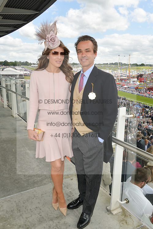 ELIZABETH HURLEY and HENRY DENT-BROCKLEHURST at the Investec Derby 2015 at Epsom Racecourse, Epsom, Surrey on 6th June 2015.