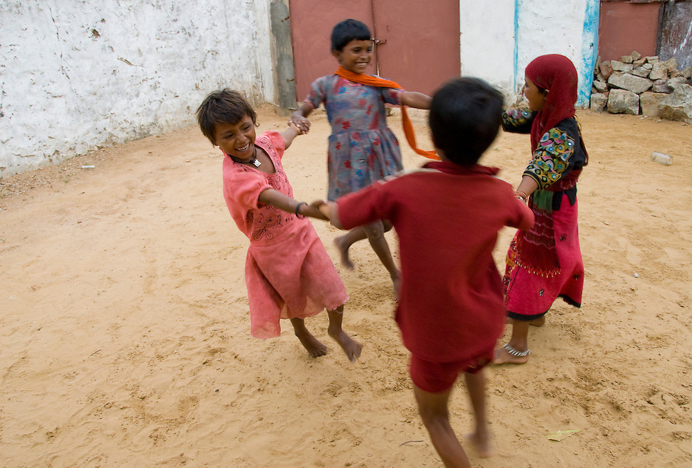 With only few or no toys, these Rajasthani children amuse themselves in the backyard of their house in a desert village of Rajasthan (India)