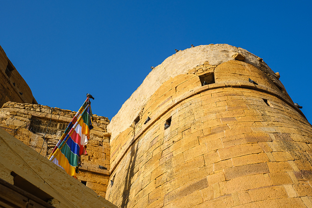 "JAISALMER, INDIA - CIRCA NOVEMBER 2018: View Jaisalmer Fort.  Jaisalmer is also called ""The Golden City, and it is located in Rajasthan. . The town stands on a ridge of yellowish sandstone, and is crowned by the ancient Jaisalmer Fort."