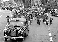 Twelfth, 12th of July, Orangemen's parade, Belfast, N Ireland, UK, 1973 - many lodges rent black taxis and in some cases swish limousines to accompany the marchers so lodge members, especially the elderly and infirm, could get rest & recuperation,197307120503v<br />