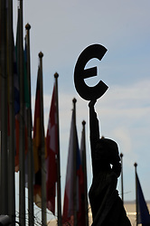 """The bronze statue """"Europe"""" sits outside the European Union parliament building in Brussels, Belgium, on Monday, Dec. 19, 2011. (Photo © Jock Fistick)."""