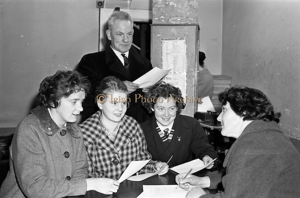 10/01/1962<br /> 01/10/1962<br /> 10 January 1962<br /> Enrolment for Irish language courses. Aine bean Ui Ghallcobhair, one of the teachers for the new Gael Linn Irish language courses, interviewing intending pupils, (l-r): Poilin Ni Aodha; Brid Ni Dubhgaill and Rosita McHugh, when they attended an enrolment session at the Gael Linn offices in Dublin.