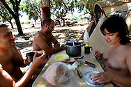 Portuguese Naturist Federation  members share a meal.