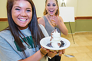 Alyson Jones, left, and Shelby Henry  share a laugh over soft serve ice cream in Nelson Commons during Bobcat Student Orientation on Thursday, June 4, 2015.  Photo by Ohio University  /  Rob Hardin