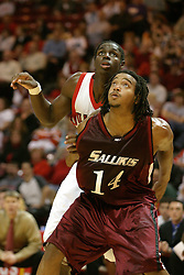 01 January 2006..Randal Falker gets position of Greg Dilligard during a free throw attempt...The Southern Illinois Saluki's chewed up the Illinois State Redbirds with 37 points in the 2nd half to beat the birds with a final score of 65-52.  An audience of just over 7500 watched the in Redbird Arena on the campus of Illinois State University in Normal Illinois.....