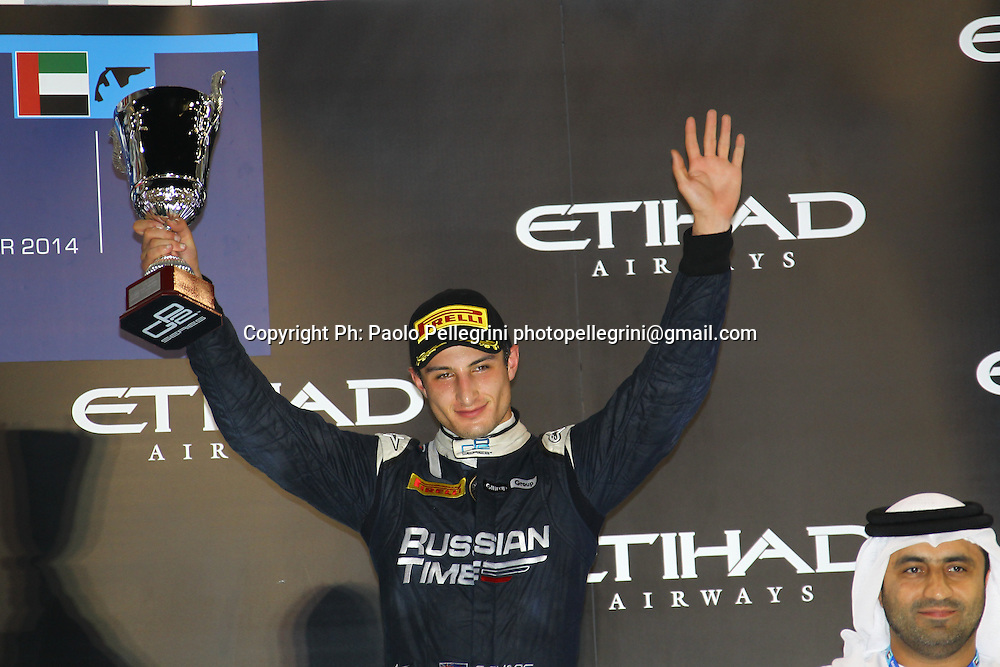 Mitch Evans (NZL) celebrates his 3rd place podium at the final round of the 2014 GP2 series at Yas Marina, Abu Dhabi. 22 November 2014. Photo: Paolo Pellegrini/www.photosport.co.nz