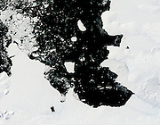 """A Chip Off the Old Block<br /> Over the course of five months in Antarctic spring and summer, NASA's Terra and Aqua satellites captured a series of images of ice island B31.<br /> <br /> In early November 2013, a large iceberg separated from the front of Antarctica's Pine Island Glacier. It thus began a journey across Pine Island Bay, a basin of the Amundsen Sea. The ice island, named B31, will likely be swept up soon in the swift currents of the Southern Ocean, though it will be hard to track visually for the next six months as Antarctica heads into winter darkness.<br /> Over the course of five months in Antarctic spring and summer, the Moderate Resolution Imaging Spectroradiometer (MODIS)—an instrument on NASA's Terra and Aqua satellites—captured a series of images of ice island B31. On this page, Terra captured the image from November 18 and December 10, 2013; while Aura acquired those from February 5 and March 11, 2014. The time-lapse video below shows the motion of the massive chunk of ice.<br /> <br /> The significance of the event is still being sorted out. """"Iceberg calving is a very normal process,"""" noted Kelly Brunt, a glaciologist at NASA's Goddard Space Flight Center. """"However, the detachment rift, or crack, that created this iceberg was well upstream of the 30-year average calving front of Pine Island Glacier (PIG), so this a region that warrants monitoring.""""<br /> PIG has been the subject of intense study in the past two decades because it has been thinning and draining rapidly and may be one of the largest contributors to sea level rise. But ice islands and icebergs are not only tracked for scientific purposes; maritime agencies follow them because of the danger they can pose to ships.<br /> A research team led by Grant Bigg of the University of Sheffield has been tracking the ice island with synthetic aperture radar and visible satellite imagery, while also modeling the drift of the ice.<br /> """"It has been very interesting how little sea ice there ha"""