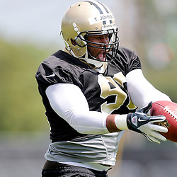 May 23, 2013; New Orleans, LA, USA; New Orleans Saints defensive tackle Tom Johnson (96) catches a pass during organized team activities at the Saints training facility. Mandatory Credit: Derick E. Hingle-USA TODAY Sports1