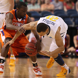 Mar 17, 2011; Tampa, FL, USA; Clemson Tigers guard Andre Young (11) steals the ball from West Virginia Mountaineers guard Joe Mazzulla (21) during the first half of the second round of the 2011 NCAA men's basketball tournament at the St. Pete Times Forum.  Mandatory Credit: Derick E. Hingle