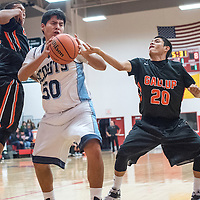 121814       Cable Hoover<br /> <br /> Window Rock Scout Brandon Chickaway (50) tries to get around a block attempt from Gallup Bengal Ronald Lee (20) during the first round of the Eddie Pena Holiday Classic Thursday at Grants High School.