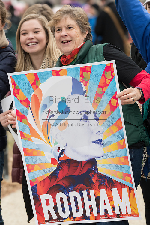 Demonstrators hold a Hillary Rodham Clinton sign during the Women's March on Washington in protest to President Donald Trump January 21, 2017 in Washington, DC. More than 500,000 people crammed the National Mall in a peaceful and festival rally in a rebuke of the new president.