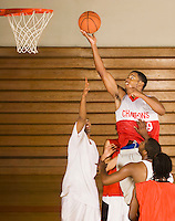 Basketballer performing lay-up in match