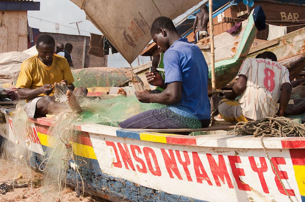 Fishermen working on their nets on the beach of New Takoradi, Ghana 2011