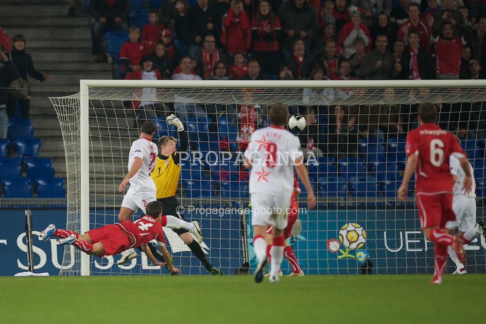 BASEL, SWITZERLAND - Tuesday, October 12, 2010: Switzerland's Valentin Stocker scores the opening goal past Wales' goalkeeper Wayne Hennessey during the UEFA Euro 2012 qualifying Group G match at St. Jakob-Park. (Pic by David Rawcliffe/Propaganda)