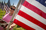 10 SEPTEMBER 2012 - TEMPE, AZ:      NANCY UHLHORN, from Phoenix, walks through the Healing Field in Tempe, AZ, Monday. The Exchange Club of Tempe and the city of Tempe are hosting the 9th Annual Healing Field display. The annual event posts three thousand American flags in the Tempe Beach Park. The flags are 3?X5?  and stand 8? tall. The display is a tribute to those who died in the terrorist attacks of September 11, 2001. Nearly 3,000 people were killed when terrorists affiliated Al-Qaeda crashed commercial airliners into the World Trade Center in New York, the Pentagon in Arlington, VA, and a field in Ohio.   PHOTO BY JACK KURTZ