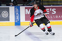 KELOWNA, CANADA - DECEMBER 8:  Brett Roulston #21 of the Prince George Cougars warms up on the ice at the Kelowna Rockets on December 8, 2012 at Prospera Place in Kelowna, British Columbia, Canada (Photo by Marissa Baecker/Shoot the Breeze) *** Local Caption ***