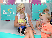 """Actress and mom Jane Krakowski plays with babies at the launch of the Pampers Cruisers #SagToSwag Tour in New York, Wednesday, Aug. 12, 2015.   In celebration of the new and improved Pampers Cruisers diapers, Pampers is going on a national tour to transform the nation's babies from """"sag to swag"""" one bottom at a time.  (Photo by Diane Bondareff/Invision for Pampers/AP Images)"""