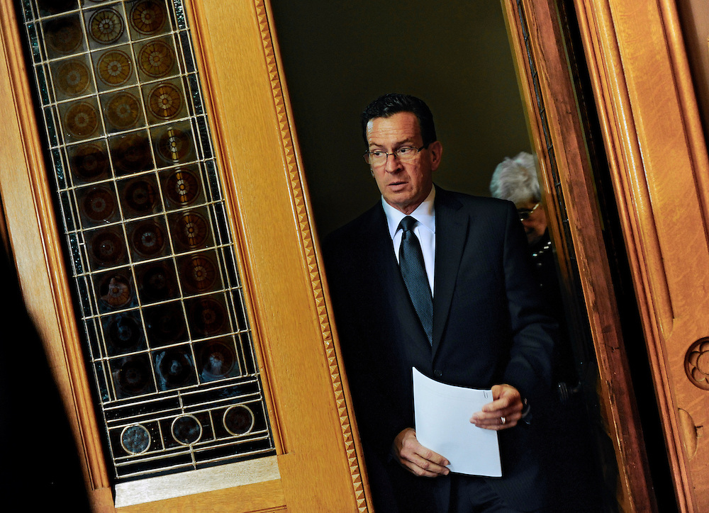 Governor Dannel P. Malloy arrives for a media briefing at the Capitol in Hartford, Conn., Monday, Dec. 17, 2012.  A gunman walked into Sandy Hook Elementary School in Newtown, Conn., Friday and opened fire, killing 26 people, including 20 children.(AP Photo/Jessica Hill)
