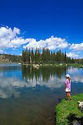 Child (age 10) on the shore of Elisabeth Lake, Tuolumne Meadows area, Yosemite National Park, California