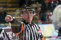 KELOWNA, CANADA - OCTOBER 7: A referee orders players to the penalty box on October 7, 2014 at Prospera Place in Kelowna, British Columbia, Canada.  (Photo by Marissa Baecker/Getty Images)  *** Local Caption *** referee;