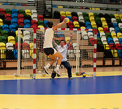 © Licensed to London News Pictures. LONDON, UK  09/06/11. A member of the British Olympic handball team jumps as she aims for a goal in the newly completed handball and goalball arena. Built for the games, the handball arena in East London is set to become one of London's largest event venues when the Olympic game finish. Please see special instructions for usage rates. Photo credit should read Matt Cetti-Roberts/LNP