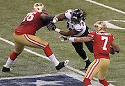 Baltimore Ravens' Pernell McPhee (90) pressures San Francisco 49ers quarterback Colin Kaepernick (7) as Anthony Davis blocks, during the second quarter of Super Bowl XLVII at the Mercedes-Benz Superdome on February 3, 2013 in New Orleans.  UPI/David Tulis