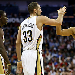 Feb 27, 2016; New Orleans, LA, USA; New Orleans Pelicans forward Ryan Anderson (33) celebrates with teammates guard Jrue Holiday (11) and guard Eric Gordon (10) after scoring against the Minnesota Timberwolves during the second half of a game at  the Smoothie King Center. The Timberwolves defeated the Pelicans 112-110.  Mandatory Credit: Derick E. Hingle-USA TODAY Sports