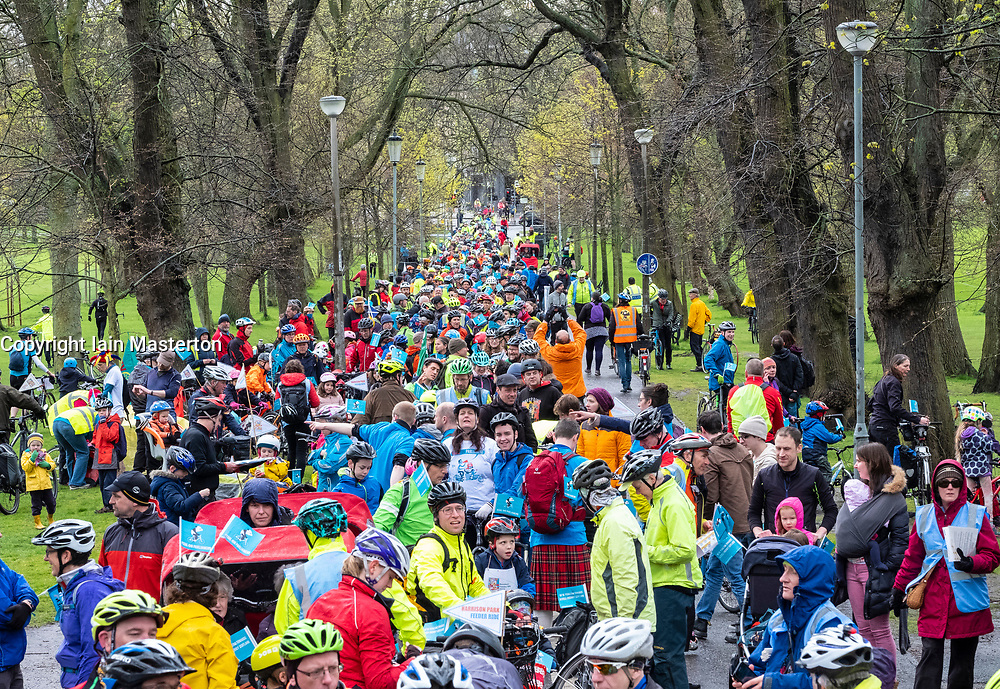 Edinburgh, UK. 28 April, 2018. Hundreds of cyclists take part in the Pedal to Parliament demonstration to highlight lack of investment in cycling infrastructure in Scotland. Starting at The Meadows park they rode along the Royal Mile in the Old Town to a rally held outside the Scottish Parliament in Holyrood.