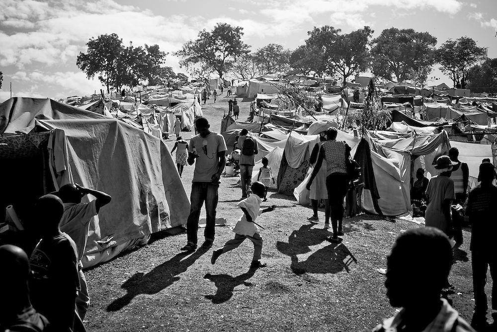 A boy runs through a camp for those displaced by the recent earthquake in Petionville, outside Port-au-Prince, Haiti.