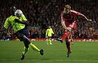 Photo: Paul Thomas.<br /> Liverpool v Barcelona. UEFA Champions League. Last 16, 2nd Leg. 06/03/2007.<br /> <br /> John Arne Riise (R) of Liverpool shoots past Lilian Thuram.