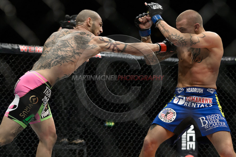 "LONDON, ENGLAND, FEBRUARY 16, 2013: Cub Swanson (L) launches a lunging right jab at Dustin Poirier during ""UFC on Fuel TV 7: Barao vs. McDonald"" inside Wembley Arena in Wembley, London on Saturday, February 16, 2013 (© Martin McNeil)"