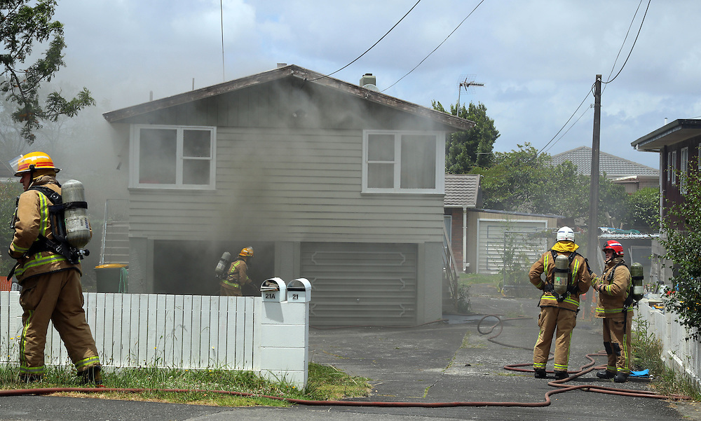 Twenty firefighters are battling a blaze which broke out in a two storey home on Royal Road, Massey, Auckland, New Zealand, Saturday, December 24, 2016. Credit:SNPA / Hayden Woodward **NO ARCHIVING**