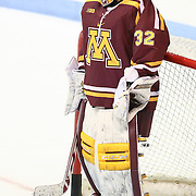 Adam Wilcox #32 of the Minnesota Gophers warms up prior to the game against the Northeastern Huskies at Matthews Arena on November 29, 2014 in Boston, Massachusetts. (Photo by Elan Kawesch)