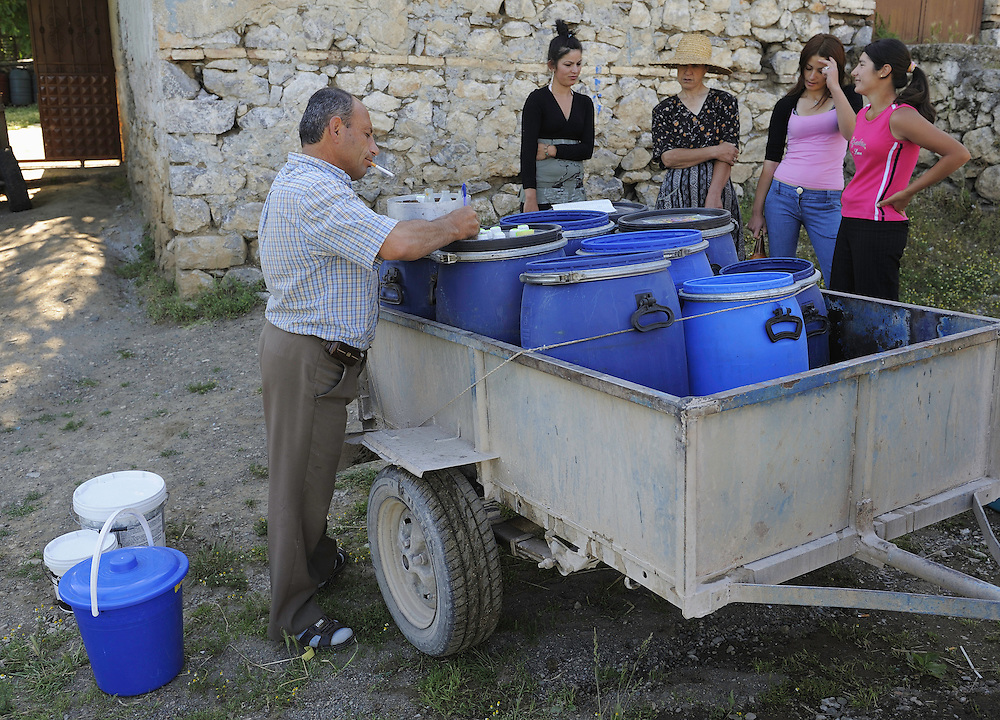 "The ""milkman"" collect the milk from the farmers. Lesser Lake Prespa, Lake Prespa National Park, Albania June 2009"