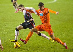 BLACKPOOL, ENGLAND - Wednesday, December 18, 2013: Liverpool's Ryan Kent in action against Blackpool's Henry Cameron during the FA Youth Cup 3rd Round match at Bloomfield Road. (Pic by David Rawcliffe/Propaganda)