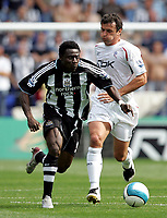 Photo: Paul Thomas. <br />Bolton Wanderers v Newcastle United. Barclays Premiership. 11/08/2007. <br /><br />Goal scorer Obafemi Martins of Newcastle gets away from Gary Speed (R).