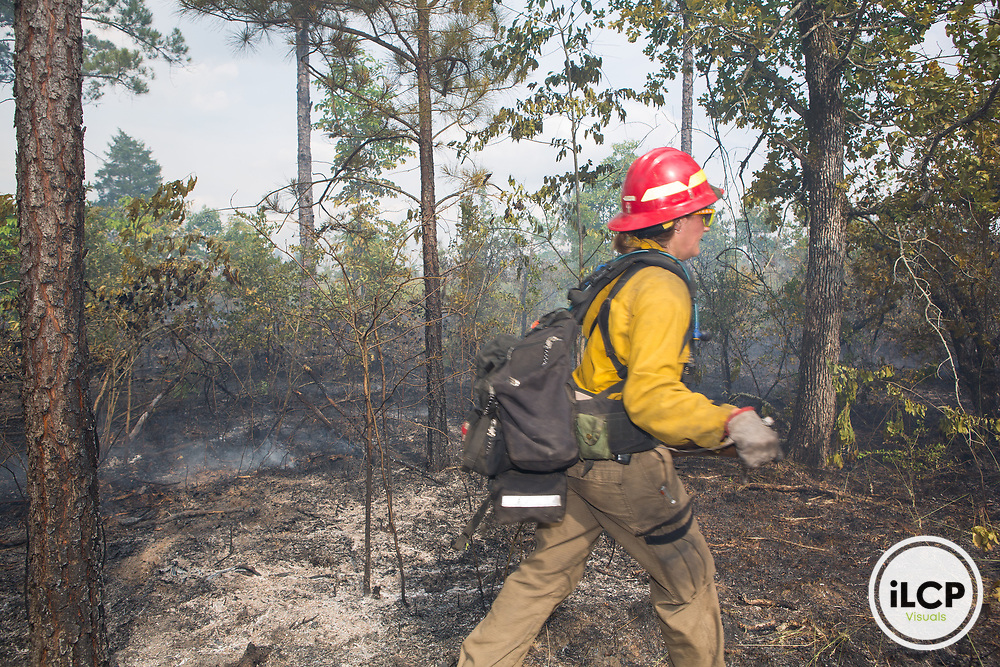 Jennifer Mueller is part of the prescribed fire team on TNC property in Georgia. Here she monitors the fire line in a prescribed fire on the Chattahoochee Fall Line preserve.