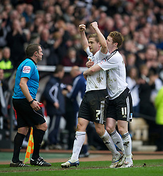DERBY, ENGLAND - Saturday, March 12, 2011: Derby County's Steve Davies celebrates scoring the second goal against Swansea City with team-mate Stephen Pearson during the Football League Championship match at Pride Park. (Photo by David Rawcliffe/Propaganda)