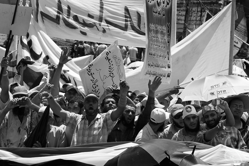 Egyptians take part in Friday prayers and protest at Tahrir Square in Cairo, Egypt July 29,2011. Nearly six months after the Jan 25 revolution, many activists, families of martyrs and victims are still struggling to obtain justice and continue with the goals they set out to achieve. (Photo by Scott Nelson for Stern)