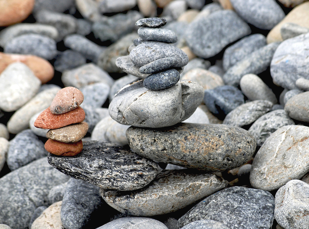 A free-form stack of balanced rocks becomes an unexpected cairn on the beaches of Big Sur