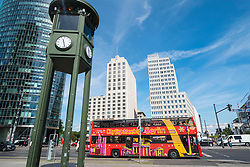 View of Potsdamer Platz business and entertainment district with hop-on hop off- tourist city tour bus in Berlin, Germany