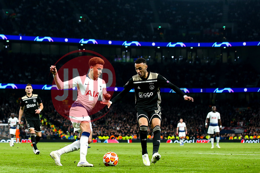 Dele Alli of Tottenham Hotspur takes on Noussair Mazraoui of Ajax - Mandatory by-line: Robbie Stephenson/JMP - 30/04/2019 - FOOTBALL - Tottenham Hotspur Stadium - London, England - Tottenham Hotspur v Ajax - UEFA Champions League Semi-Final 1st Leg