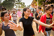 16 MARCH 2013 - NONG SA, LAOS: A woman dances in a traditional Lao style at the temple fair at Wat Nong Sa in the village of Nong Sa, which is on Highway 13, in Vientiane province of Laos.  PHOTO BY JACK KURTZ