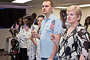 June 21, 2010 - PHOENIX, AZ: POGORCLE VASILIJA (RIGHT), from Bosnia, and ROBERT DJILAS, from Croatia, say the Pledge of Allegiance during a naturalization ceremony for former refugees at the International Rescue Committee offices in Phoenix, AZ, Monday, June 21. World Refugee Day was Sunday, June 20; the IRC and US Citizenship and Immigration Services offices  marked the day by holding a naturalization ceremony for 10 people who came to the US as refugees.  Photo by Jack Kurtz