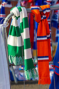 Rangers and Celtic scarves beside each other on the impromptu memorial at the gates of Ibrox Stadium, Glasgow, Scotland to Fernando Ricksen, the former Rangers player, who sadly passed away the day before the Europa League match between Rangers FC and Feyenoord Rotterdam on 19 September 2019.